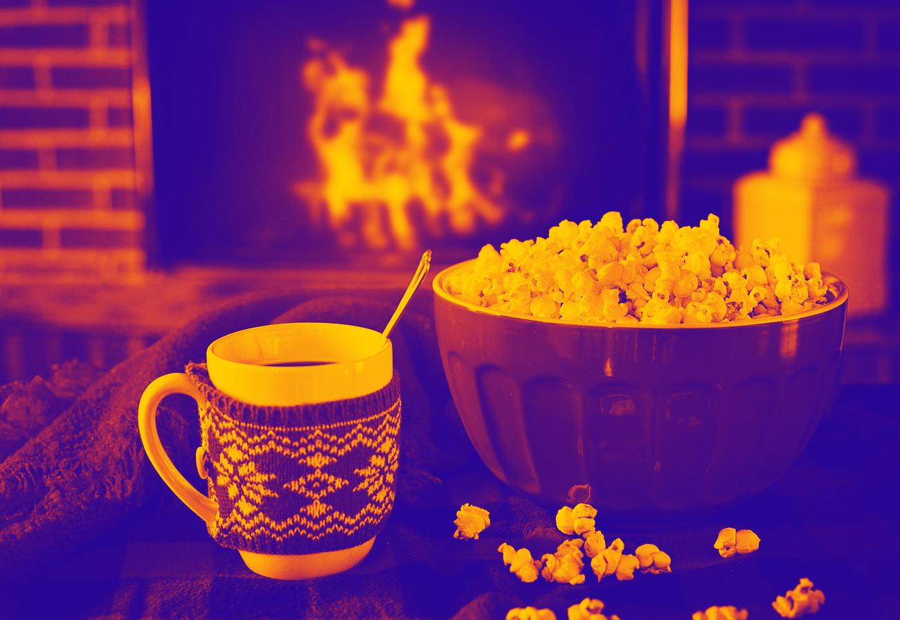 hot chocolate and popcorn in front of fire at christmas